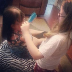 bella and linda playing beauty shop